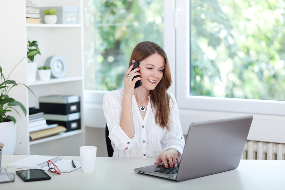 woman on phone shutterstock_301394078